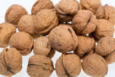 Walnuts heap isolated on white background — Stock Photo