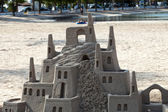 A beautiful sand castle on a beach. — Stock Photo