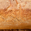 Loaves of bread traditionally roasted. Background. Close up. — Stock Photo #41565555
