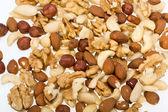 Background of mixed nuts -  hazelnuts, walnuts, cashews,  pine nuts — Stock Photo