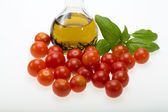Basil, tomatoes and olive oil with the thyme — Stock Photo