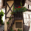Street with half-timbered medieval houses in Eguisheim village — Stock Photo