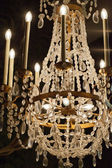 The crystal chandelier in the castle  Chambord — Stock Photo