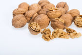 Walnut and a cracked walnut isolated on the white background — Stock Photo