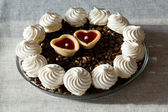 French vanilla meringue cookies and two sweet hearts — Stock Photo