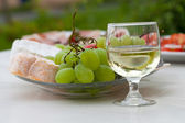 Various sorts of cheese, grapes and glass of the white wine — Stock Photo