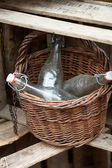 Empty, old bottles in the basket — Stock Photo
