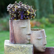 The flower pot in the form of the feminine head — Stock Photo #49309003