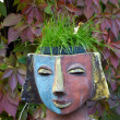 The flower pot in the form of the feminine head — Stock Photo #49309271