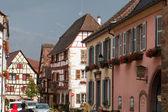 Street with half-timbered medieval houses in Eguisheim village along the famous wine route in Alsace, France — Stock Photo