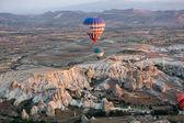 Hot Air Baloon over Cappadocia at sunrise. Turkey — Stock Photo