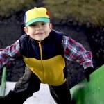 Boy on slide — Stock Photo #1800516