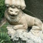 Stone chinese lion — Stock Photo #12468250