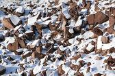 Stones covered snow — Stock Photo