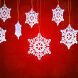 White Snowflakes on the Red Background - Stock Photo