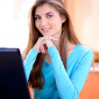 Portrait of a beautiful young lady working with laptop in the kitchen at home — Stock Photo