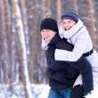 Young Beautiful Couple Taking Fun and Smiling Outdoors in Winter — Stock Photo #18876843