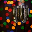 Two Glasses of Champagne against Blurred Christmas Lights — Stock Photo