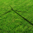 Wind Generator Turbine Shadow on the Grass - ストック写真