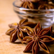 Stock Photo: Star Anise in Glass Bowl on Wooden Table