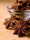 Star Anise in the Glass Bowl on Wooden Table — Stock Photo