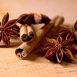 Stock Photo: Star Anise and Cinnamon Sticks on Wooden Table