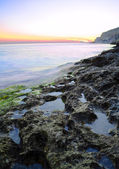 Rocks in the Sea against Beautiful Sunset — 图库照片