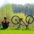 Cyclist Sitting on the Grass Near His Bike — Stock Photo