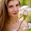 Young Beautiful Woman with Pink Sakura Flowers — Stock Photo