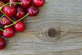 Group of Fresh Ripe Red Sweet Cherries on Wooden Background — Stock Photo