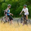 Young Happy Couple Riding Mountain Bikes Outdoor — Stock Photo #30226205
