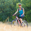 Young Attractive Woman Riding the Bike in the Beautiful Forest — Stock Photo