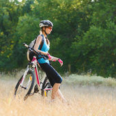Young Attractive Woman Resting with Bike in the Beautiful Forest — Stock Photo