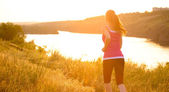 Young Beautiful Woman Running on the Mountain Trail in the Morning — Stock Photo
