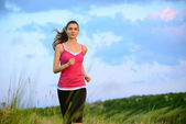 Young Beautiful Woman Running on Mountain Trail in the Morning — Stock Photo