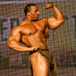 Bodybuilder posing — Stock Photo #14071929