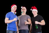 Three man wearing santa hat — Stock Photo