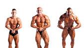 Bodybuilders flexing — Stock Photo