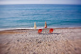 Beach umbrellas with chairs — Stock Photo
