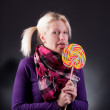 Stock Photo: Womholding lollypop