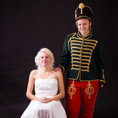 Beautiful bride and hussar — Stock Photo