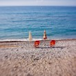 Stock Photo: Beach umbrellas with chairs