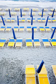 Beach umbrellas with chairs — Stock Photo