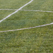Green soccer field — Stock Photo #48029611
