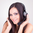 Beautiful young female with headphones — Stock Photo