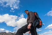Portrait of young hiker man with backpack — Stock Photo
