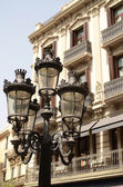 Old street lamp with beautiful old building .Barcelona — Stock Photo