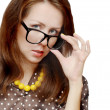 Portrait of young woman in large severe glasses — Stock Photo