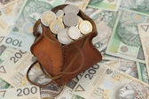 Coins and banknote — Stock Photo