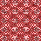 Red and white knitted snowflakes background — Cтоковый вектор